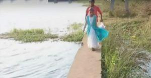 റോഡില്ല, തടയണയുടെ സംരക്ഷണ ഭിത്തിയിലൂടെ നാട്ടുകാരുടെ അപകടയാത്ര