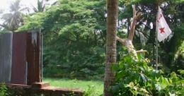 സ്വകാര്യവ്യക്തിയുടെ ഭൂമിയില് ഡി.വൈ.എഫ്.ഐ കുത്തിയ കൊടി അഴിച്ചുമാറ്റി