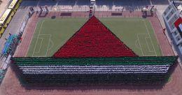 4,882 വിദ്യാർഥികൾ അണിനിരന്നു; ഷാർജയിൽ 'മനുഷ്യ ബോട്ടി'ന് ഗിന്നസ് റെക്കോർഡ്