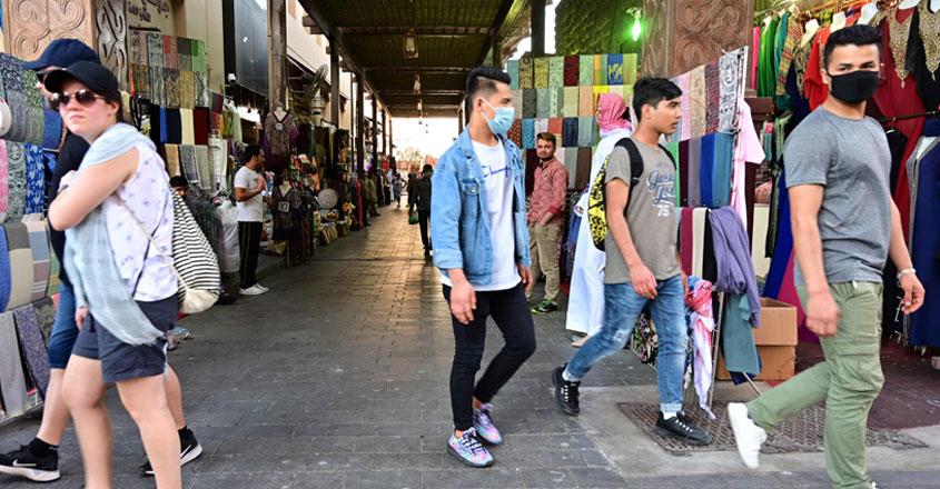 people-walking-past-shops-845
