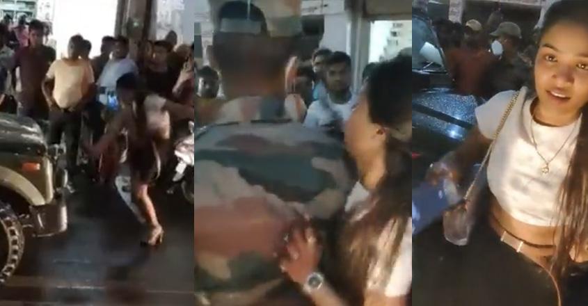 drunken-women-blocks-vehicle