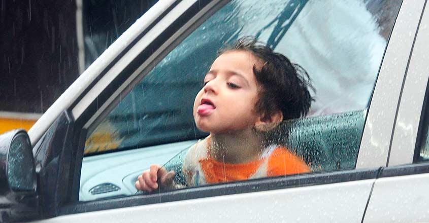 kid-enjoying-rain